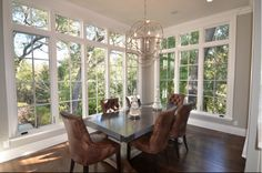 Great light in this dining room.. could be a mountain house