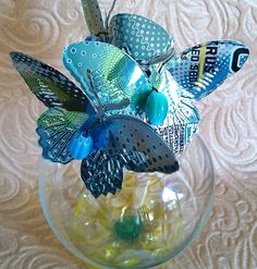 light bulb bud vase with soda can butterflies
