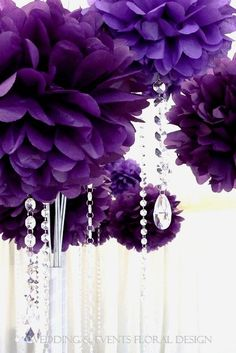 Purple paper pom poms with hanging crystals . -Loved and repinned by www.evolationyoga.com