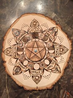 Pyrography also know as the art of woodburning. This large basswood alter piece is adorned with the Wheel of the Year representing the Pagan