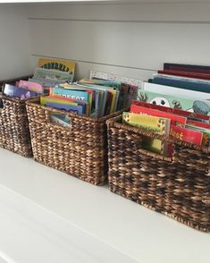 Organize kids books in baskets on a shelf to keep the play room neat and organized. Teach your children how to clean and organize! - Neatly Designed, organizer, organizing expert, clearing the clutter Bookshelf Organization, Playroom Storage, Kids Room Organization, Kids Storage, Living Room Storage, Diy Books Organizer, Book Storage Kids, Tv Storage, Record Storage
