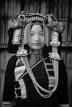 Laos, Akha hill tribe, lady with traditional headdress.