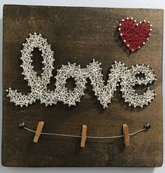 Just in time for Valentines Day! Hand stained wood, Love string art board with wire picture holder. Can easily hold 2 4 pictures on the wire with small clothes pins (included). Great gift idea for home decor, holidays, or weddings! Custom colors can be r Valentines Day Decorations, Valentine Crafts, Valentine Day Gifts, Wire Picture Holders, Picture Hangers, String Wall Art, Nail String Art, Arte Linear, String Art Patterns