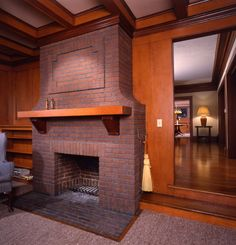 Sunroom fireplace, back to back with living room fireplace, was also restored. Purple-hued brick like this was popular in Craftsman era, and...