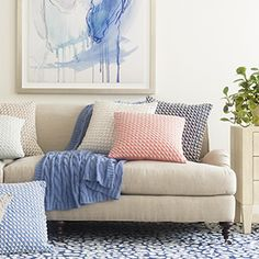 I adore the cable-knit blue throw.