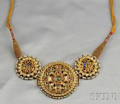 Antique High-Karat Gold, Gem-set, and Enamel Necklace, India, set with various colored stones and pastes, seed and split pearl accents, reverse with polychrome enamel, completed by a finely woven cord, lg. to 32 in.
