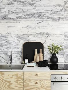 Another amazing marble back splash--I can't seem to get enough. The additional texture brought by the cabinetry also plays well off the smoothness of the solid counter and the sleek stainless