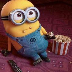 Watching movie, eating popcorn.