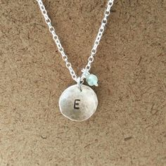 **SNEAK PEEK** one of our gorgeous pieces from our personalised range, initial stamped silver dome with 4mm birthstone bead! #handmadejewelry #personalized #gifts #silver #ElizabethGillard #birthstone