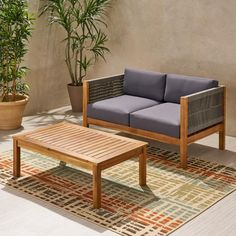 With our loveseat and coffee table set, you can easily establish an area in your outdoor space for serene relaxation and cozy style. This charming set brings together stunning, hand-crafted rattan rope weave with the smooth material of rich acacia wo Patio Loveseat, Patio Chairs, Patio Furniture Sets, Outdoor Furniture, Rattan Furniture, Garden Furniture, Coffee Table Dimensions, Outdoor Sofa, Outdoor Decor