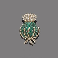 An early twentieth-century emerald and diamond brooch in the form of a thistle, symbol of Scotland. (Bonhams)