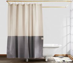 To create this canvas shower curtain, Michael and Lisa of Quiet Town took inspiration from the horizon lines, neutral colors and open skies of Long Island. The Orient's pattern is simple and brings the beach your bathroom. Each curtain is ha…