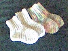 Crocheted Baby Socks Pattern Just finished making these. A few notes for myself: 34 sc when making foot, not 32. Which makes Rnd 2: 1 sc in next 7 sc, 2 sc tog (twice) 1 sc in next 4 sc, 2 sc tog (twice), 1 sc in next 4 sc, 2 sc tog (twice), 1 sc in next 7 sc, ss to join, ch 1, turn. (28 sc)