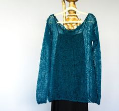 Dark teal loose knit sweater ; hand knit bohemian sweater made airy knit,very light,semi sheer and still warm.Soft mohair sweater is perfect for casual and everyday usage, made loose fit,will go perfect with jeans and may combine easily with many colors.  Material : mohair,wool and acrylic mixed yarn.  **Please message me your heigth and weigth during check out ; then I can make the perfect fit!**  Available sizes and measurements for the mohair boho sweater;  Small (S) ; Bust: 30 _ 76 cm…