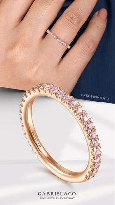 Embrace your softer side with this effortlessly feminine stackable ring. The simple, scalloped band is crafted from polished 14k rose gold. Round pink zircon stones are positioned throughout for a charming pop of color. LR50889K4JPZ #StackableRings #RoseGoldRing #PinkZirconRing #FashionJewelry #Rings #FashionRings