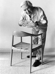 HANS J. WEGNER with 'The Round Chair' from 1949.