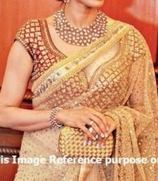 Bollywood Sridevi Golden Saree with Gold Foil Print all over. Embroidered blouse piece.