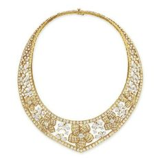 Price Realized – $74,500    Lot Description    A DIAMOND AND GOLD NECKLACE, BY VAN CLEEF & ARPELS  The V-shaped openwork band designed as a graduated series of circular-cut diamond and sculpted 18k gold flower blossoms, spaced by circular, marquise and pear-shaped diamond clusters, to the circular-cut diamond trim, mounted in 18k gold, 15 ins., with French assay mark and maker's mark, in a Van Cleef & Arpels brown suede case