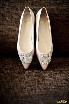 The bride wore a pair of embellished flats in a dainty shade of pink. The shoes were ordered online, and custom-made and fashioned after a famous pair from Manolo Blahnik.