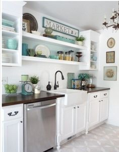 White kitchen!  Wish I could have open shelving but don't think I have enough matching cute serving stuff to have on display!