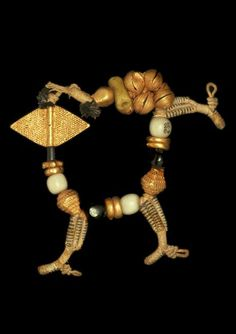 Africa | Bracelet / amulet (suman) composed of 10 small lost wax cast beads in gold, including a flat lozenge (nwato), 6 glass beads, 8 lost wax cast gold crotal bells. Asante people, Ghana. Possibly from the Royal Palace, Kumase | 19th century