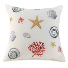 In their most comfortable form ever, enjoy the treasures of a low-tide beach with this lovely off-white cushion embroidered with colorful shells, coral, and starfish. This pillow is a shore bet when you're looking to add a touch of seaside whimsy to your decor.