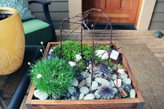 fairy garden - note not only arbor, but tiny pots, watering can and birdhouse!