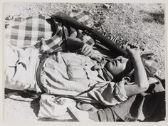 Republican soldier sleeping on the ground after a three day battle, Cordoba front, 1936//Robert Capa