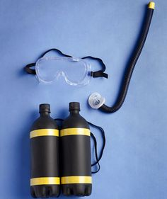 Homemade oxygen tank, goggles and airtube for Scuba Diver costume  Oxygen Tank- is 2 -One liter bottles,  Black spray paint,Yellow utility tape,  Black shoe laces,  gun    Make Mouth Device    What You Need  Black cord covers  Pacifier  Hot glue gun    1. Cover one end of the cord with yellow tape.    2. Glue pacifier to the other end of the cord cover. Let dry overnight. Homemade Costumes, Diy Halloween Costumes, Halloween Crafts, Holidays Halloween, Diy Costumes For Boys, Scuba Diver Costume, Kids Dress Up, Dress Up Costumes, Fun Costumes