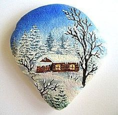 nice cabin painting on a rock.