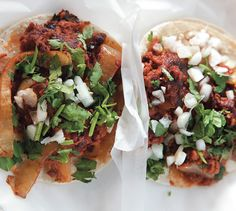 1 teaspoon vegetable oil   1/2  onion, sliced    2 teaspoons chopped seeded jalapeño chile   1  12-ounce package soy chorizo (sometimes labeled Soyrizo), casing removed   1  15.4-ounce to 16-ounce can vegetarian refried black beans   12  corn tortillas, warm      Diced onion     Chopped fresh cilantro