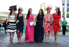 And they're off! A group of ladies show off their race day looks, several complete with go...