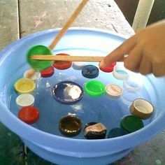 Fine motor lifting objects with various tools including large tweezers chop sticks explore Preschool Learning Activities, Motor Activities, Sensory Activities, Infant Activities, Preschool Activities, Fine Motor Skills, Games For Kids, Kids Playing, United Nations