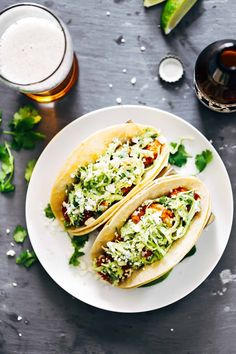 These Spicy Shrimp Tacos with Garlic Cilantro Lime Slaw From Pinch of Yum are ready in 30 minutes. Great for a weeknight dinner.