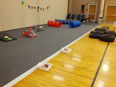 Simple Pinewood Derby Decorations and games. Gathering activity-Tires, tunnels, beanbag toss, road and toy cars.