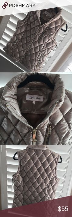 NWT! Calvin Klein Premium Down Vest size Medium essential puffer vest from Calvin Klein updates your cold-weather look with modern-luxe appeal. Woman's size Medium. New with tags! Calvin Klein Jackets & Coats Vests