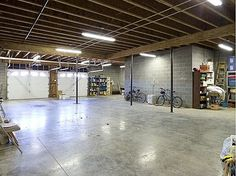 A large man cave underground where I will store and work on my automotive collection.
