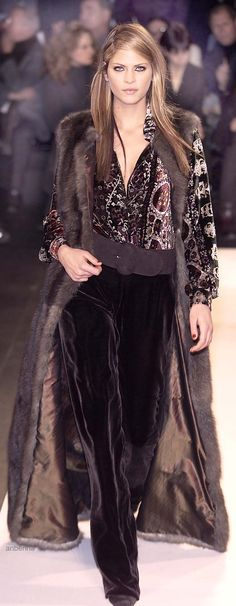 Oscar de la Renta.  I love fur and I love velvet.  And I love the colors in this outfit, too.