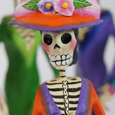 This Michoacán artisan has created a variety of colorful paper mache catrinas especially for Day of the Dead, November 1 & 2. These lovely ladies are each dressed uniquely in their paper mache hats, painted dresses and matching shoes. The hats are removeable. They are well dressed because they are