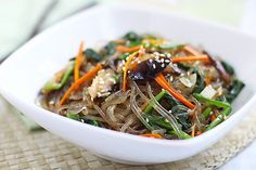 Japchae or chap chae is a popular Korean noodle dish made with sweet potato noodles. Learn how to make japchae at home in 30 minutes. Easy japchae recipe.