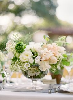 The coffee tables will have silver compotes filled with blush garden roses, seasonal greenery, white peonies, blush spray roses, and white ranunculus.
