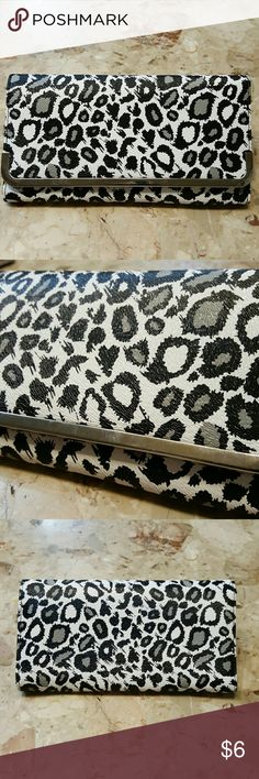 """Wallet Leopard Print Wallet.  NWT, it has a snap close & lots of slots inside for your cards, etc.  It has a zippered coin compartment also.  It meadures 7.5"""" x 4"""".  Feel free to ask any questions before purchasing.   Thanks for shopping my closet! Bags Wallets"""