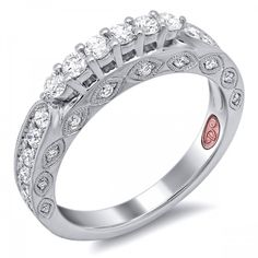 DemarcoJewelry.com  Available in White or Yellow Gold 18KT and Platinum. 0.70 RDCapture her grace and endless beauty with this confident yet elegant design. We have also incorporated a unique pink diamond with every single one of our rings, symbolizing that hidden, unspoken emotion and feeling one carries in their heart about their significant other. This is not just another ring, this is a heirloom piece of jewelry.   Demarco Bridal Engagement Ring.