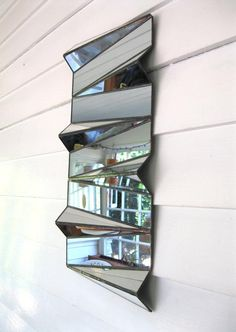 This sculptural mirror by Portland artist Sara Collins is inspired by the limitless possibilities of math and science.