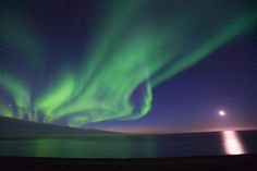 Photo of the moon and Northern Lights over the Arctic Ocean off the coast of the Arctic National Wildlife Refuge in Alaska. Description from pinterest.com. I searched for this on bing.com/images