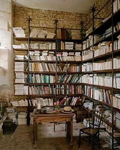 Stone walls and bookshelves.