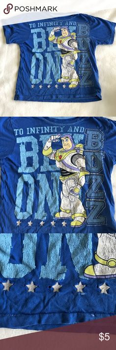 Disney Buzz Lightyear Shirt Size XS (4) Disney Buzz Lightyear Shirt Size XS (4).   Small holes at the bottom of the shirt by the stars as seen in the picture.  Bundle with another item in my closet and save 10% and save on shipping! Disney Shirts & Tops Tees - Short Sleeve