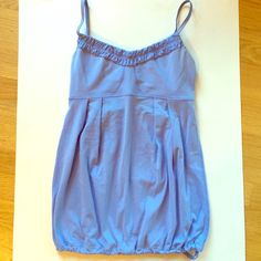 "Lululemon Tank Super cute periwinkle color and flowy bodice with an adjustable pull elastic bottom, however armpit area is stained a bit and top does not include padding. Approx 20"" long. lululemon athletica Tops Tank Tops"