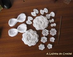 Crochet flowers and ribbons in white.