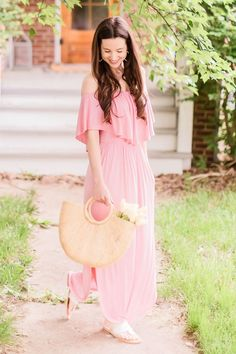 Affordable fashion blogger Stephanie Ziajka styles a pink off shoulder maxi dress (which is under $30!) with a retro round handle straw handbag, white Jack Rogers sandals, and gold Kendra Scott Sophee earrings in today's casual summer outfit post! Click through for pink maxi dress outfit details plus dozens more casual summer outfit ideas for women. #amazonfashion #maxidress #summeroutfit #affordablefashion